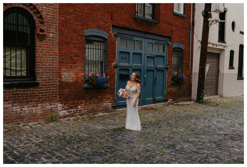Excited bride during first look wedding photos on Court Street in Hoboken