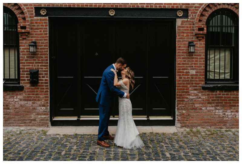 Couple kisses during first look wedding photos in Hoboken