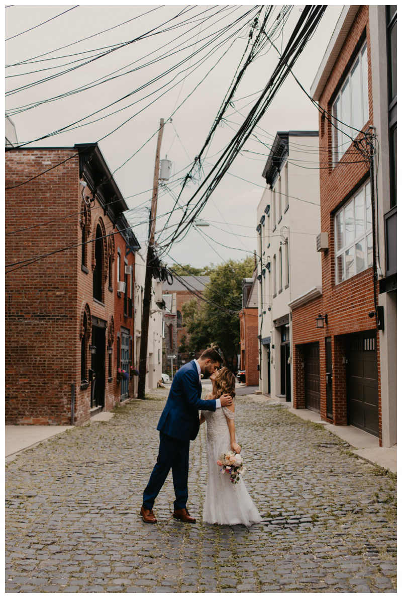 Bride and groom kiss on Court Street during Hoboken microwedding in NJ captured by best Hoboken wedding photographer Mile Square Moments