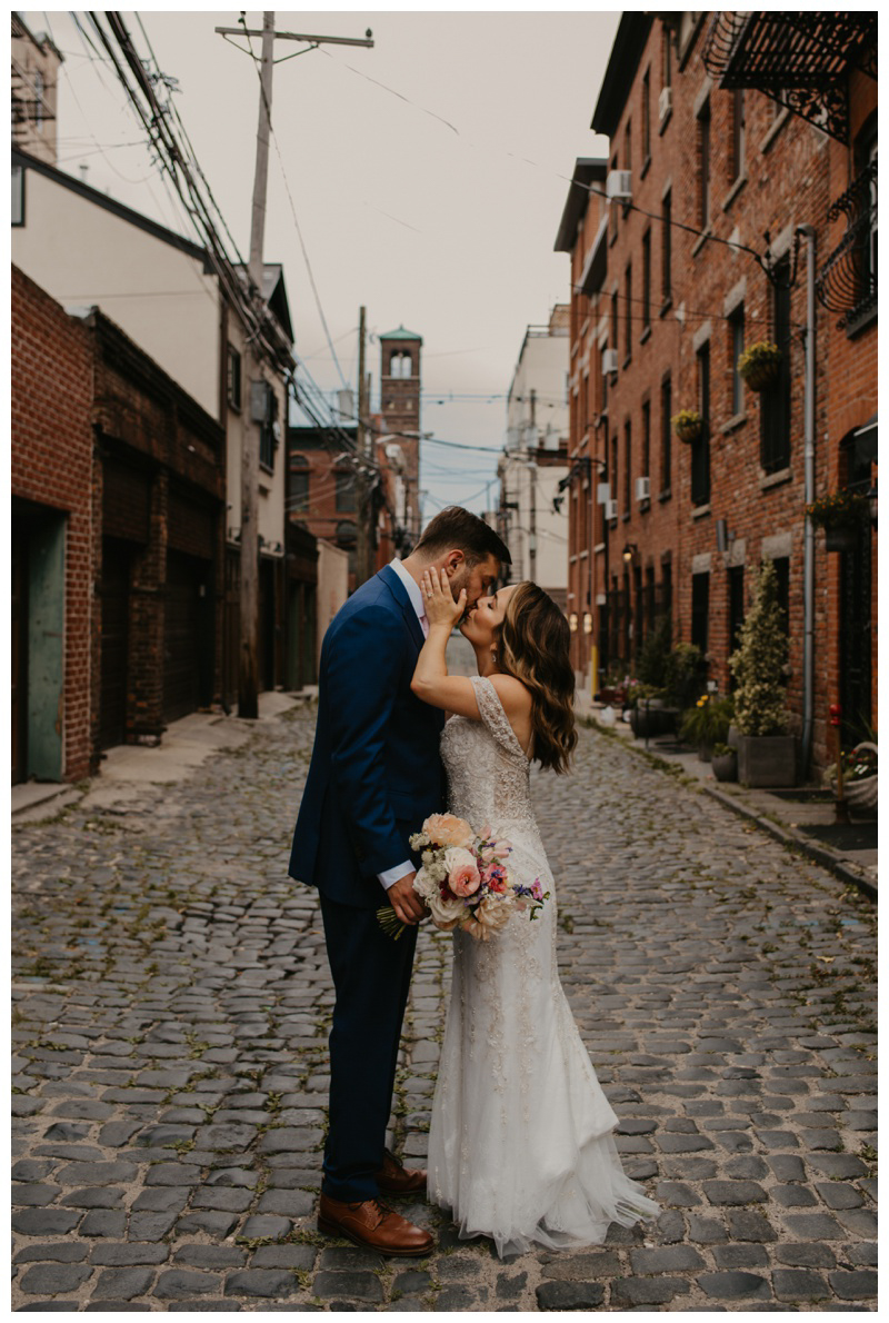 Bride and groom kiss during Hoboken microwedding in NJ captured by best Hoboken wedding photographer Mile Square Moments
