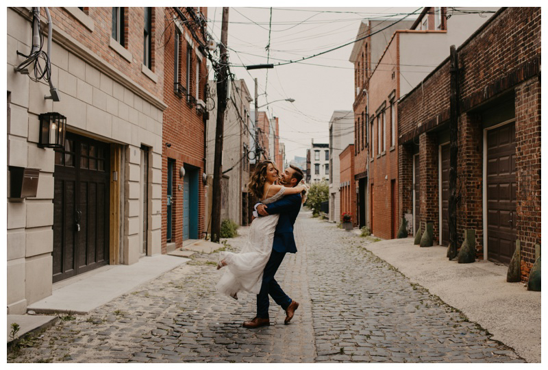 Happy bride spun by groom on Court Street during Hoboken microwedding in NJ captured by best Hoboken wedding photographer Mile Square Moments
