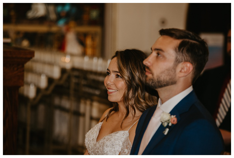 Happy bride and groom during St. Francis Church wedding ceremony in Hoboken