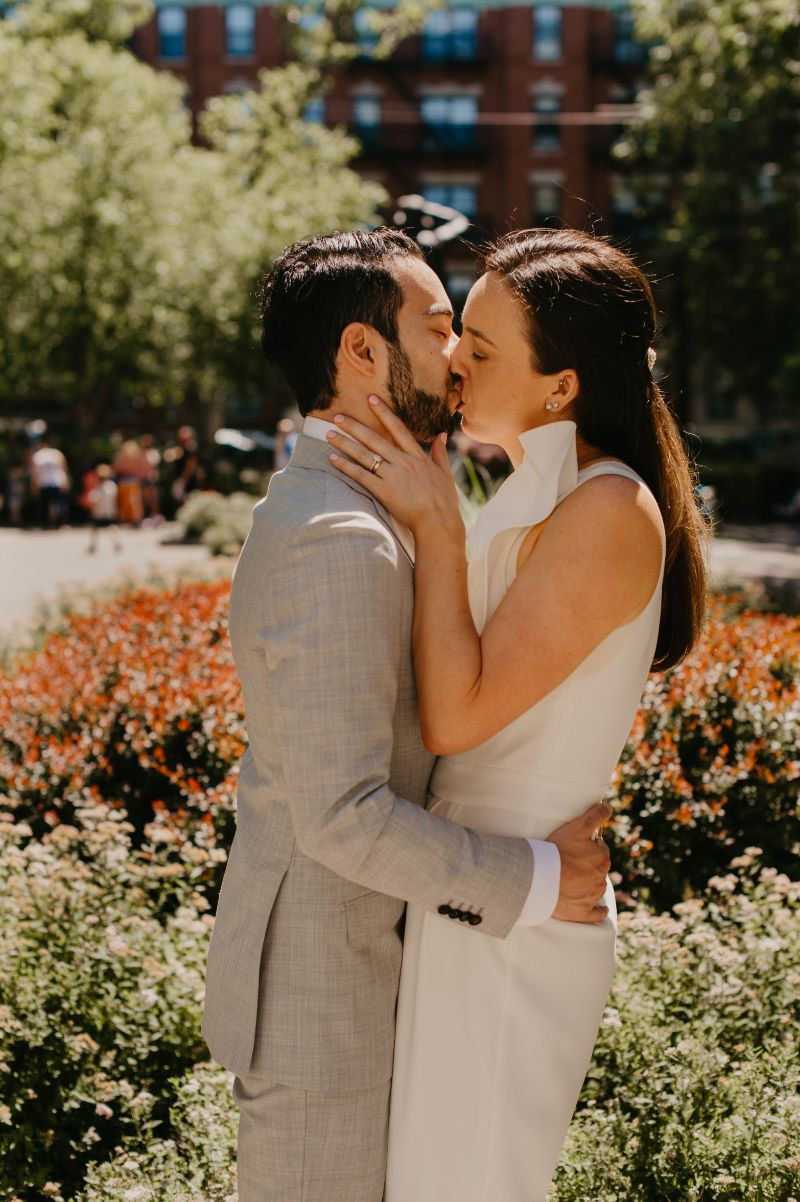 Last minute elopement in Hoboken New Jersey - first kiss in Columbus Square Park
