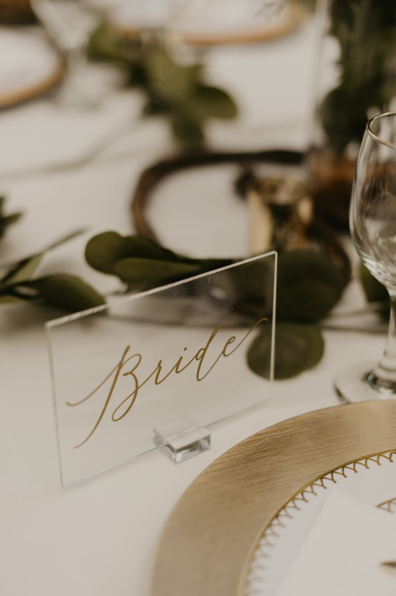 acrylic bride sign at reception table
