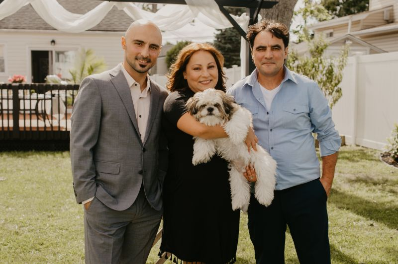 dog takes center of attention in wedding photos