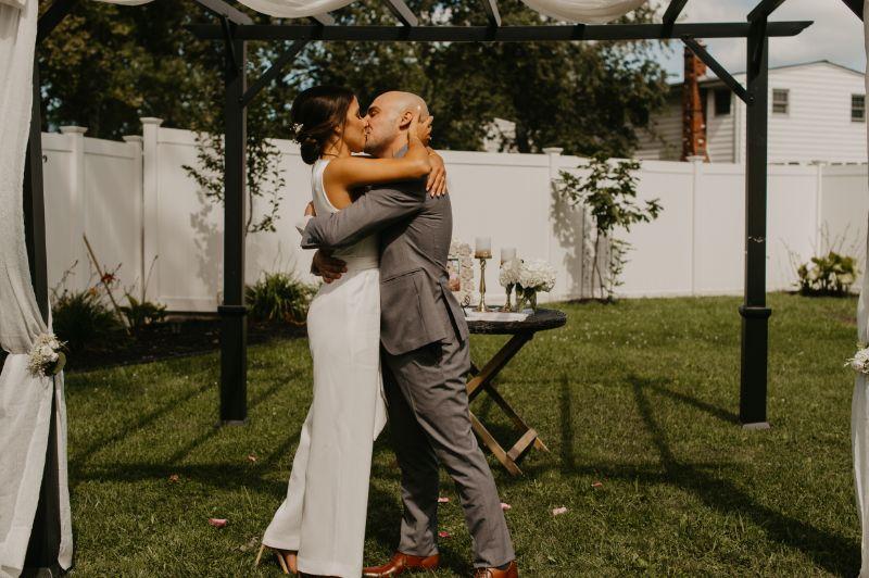 Backyard wedding first kiss in new jersey