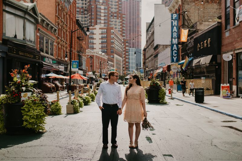 bride and groom pose ideas in jersey city on main street