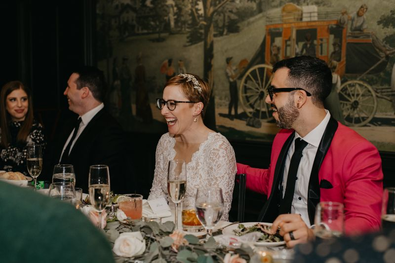 Bride laughing at Aurora Inn wedding reception