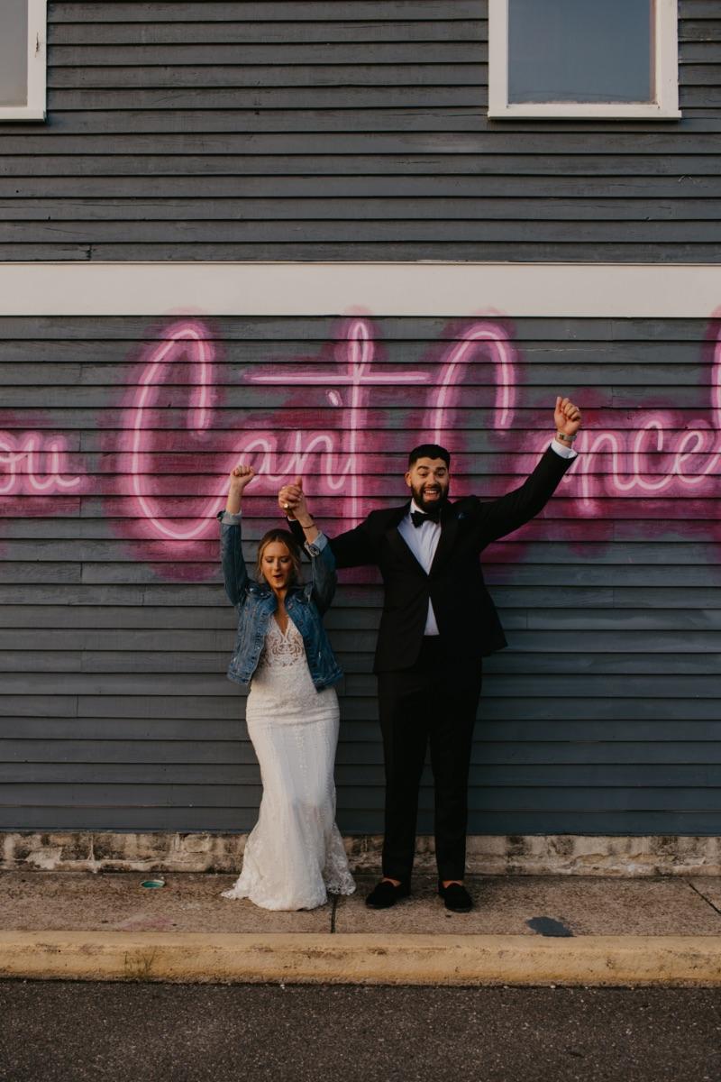 Wedding Photos at Sunset on Long Beach Island next to Graffiti Art