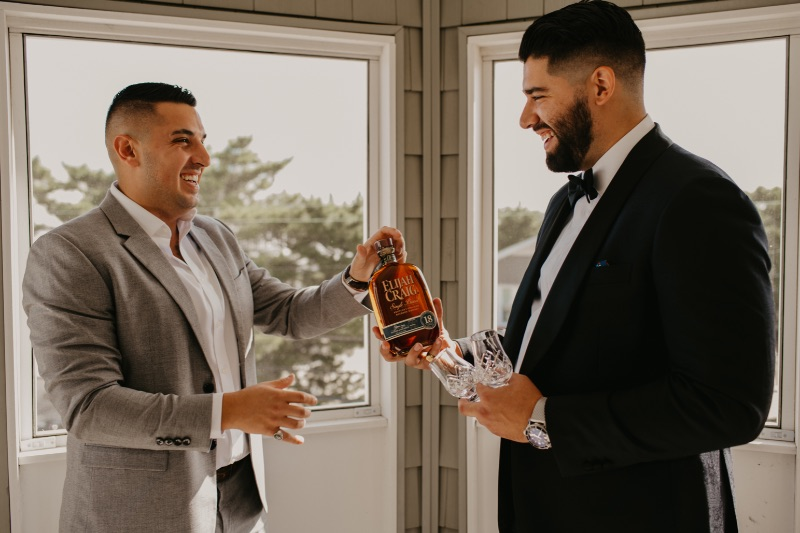 Getting Ready photos with groom and groomsmen in beach house Long Beach Island New Jersey