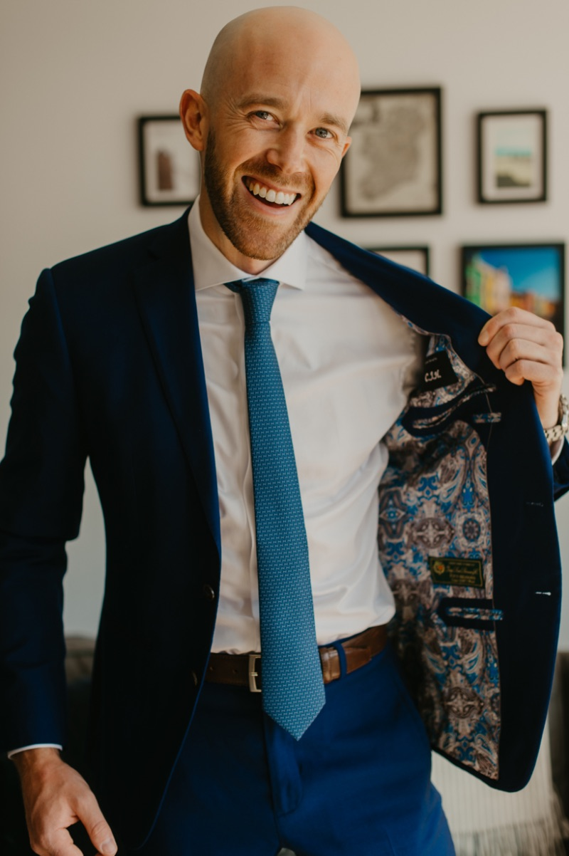 Groom with fun Enzo custom suit with pattern on inside