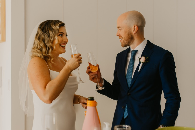 Bride and Groom with champagne in apartment before their Long Island Elopement