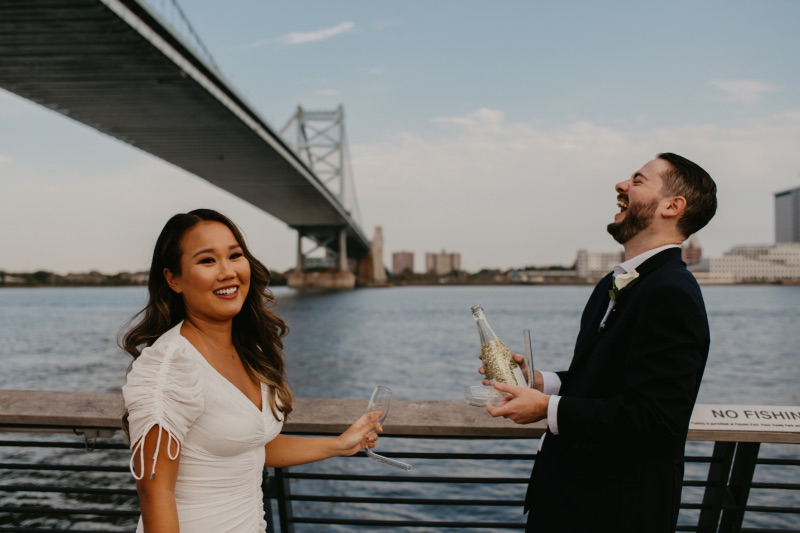 Chambong bride and groom drinking champagne