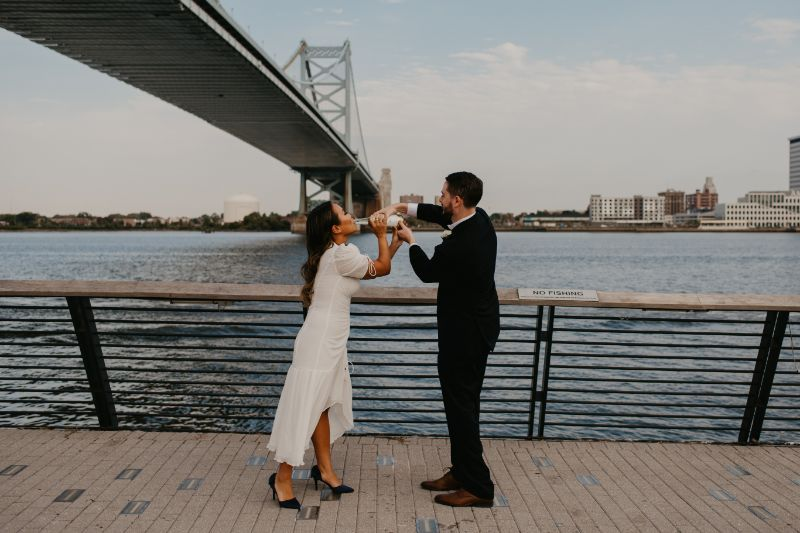 Bride and Groom popping champagne photos