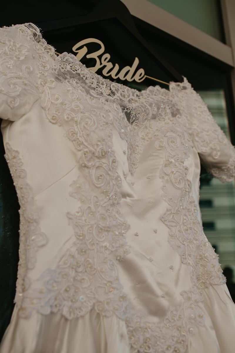 mothers wedding dress on bride hanger