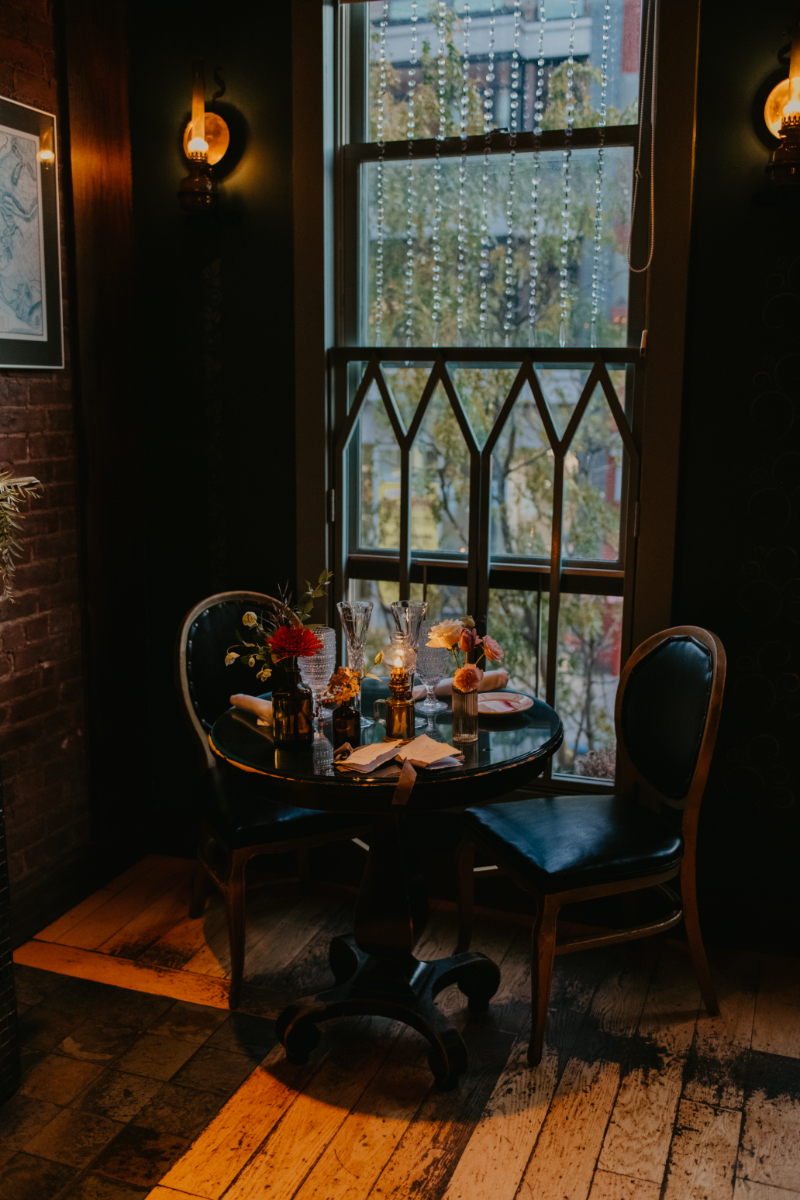 sweetheart table at New Jersey wedding in dark and moody restaurant