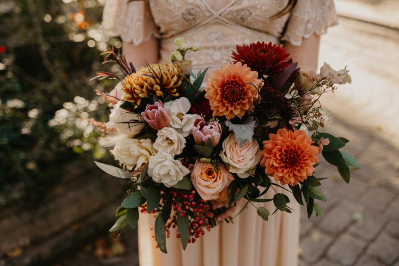 Orange Wedding Flowers in Bouquet, Bride's Hair and Groom Boutonniere