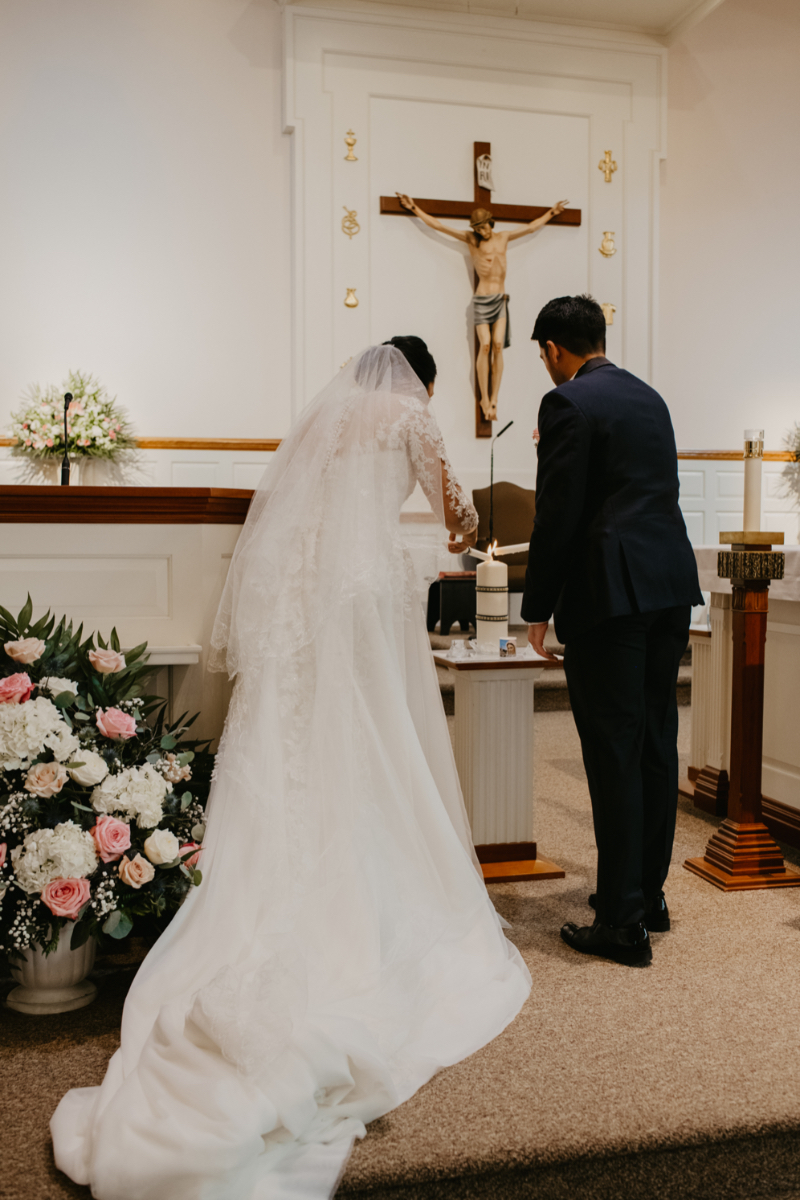 Filipino Catholic Wedding Ceremony in New Jersey lighting unity candle
