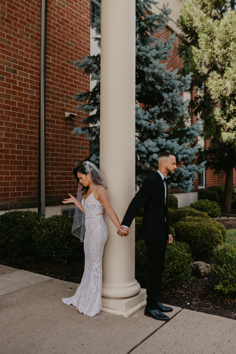 Couple prays together before the church ceremony in New Jersey