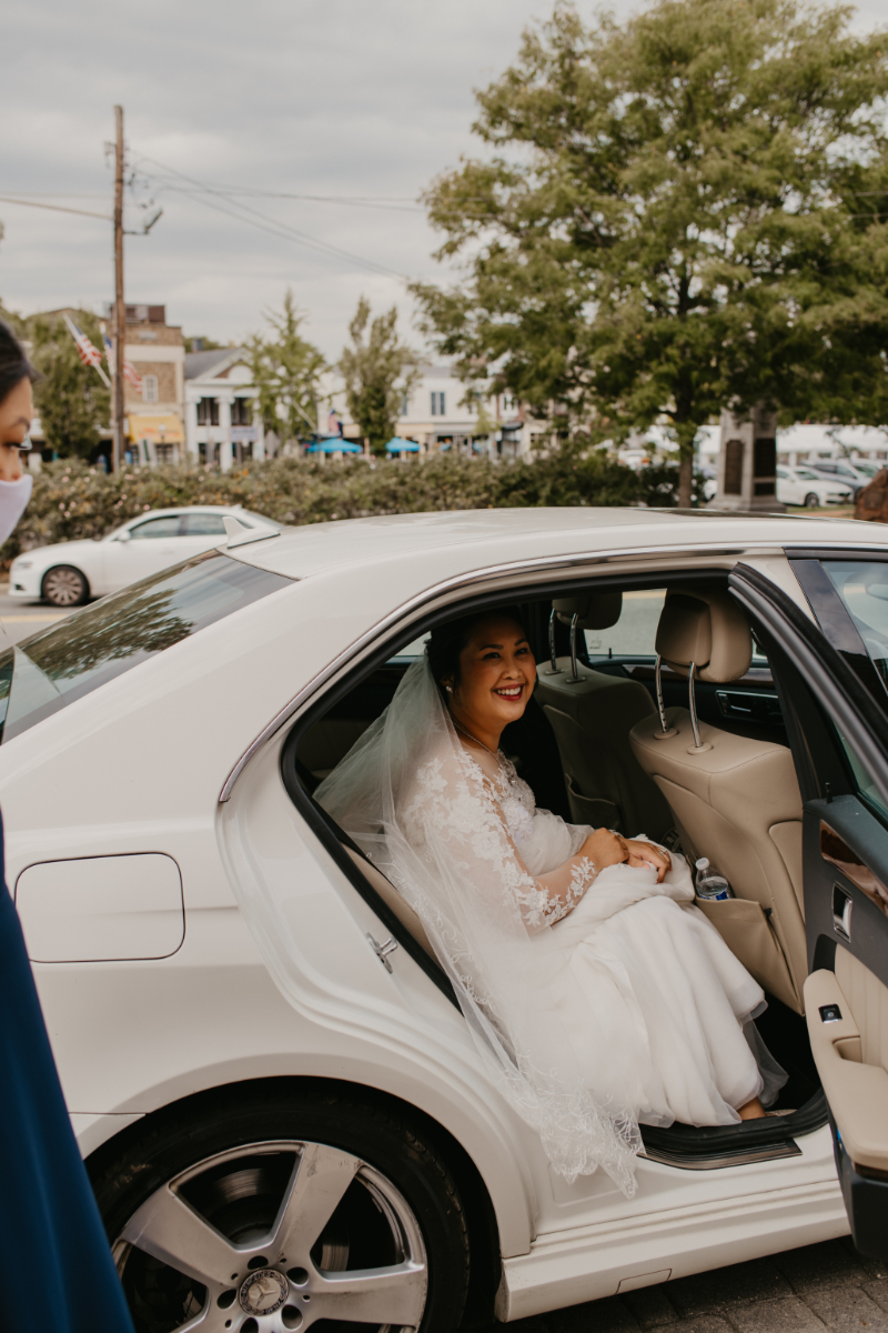 Bride arriving in car at ceremony location in New Jersey