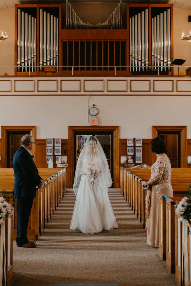 Bride walking down the aisle at Our Lady of Most Carmel