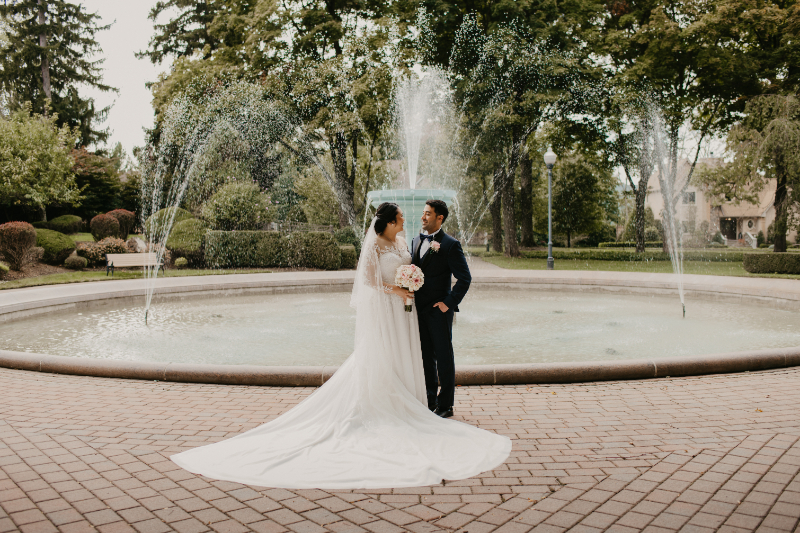 Bride and Groom Portraits in front of a water fountain