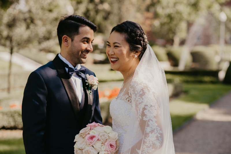 Bride and groom smiles during outdoor photos