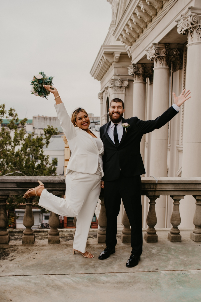 Bride holding bouquet with groom celebrate after eloping in jersey city