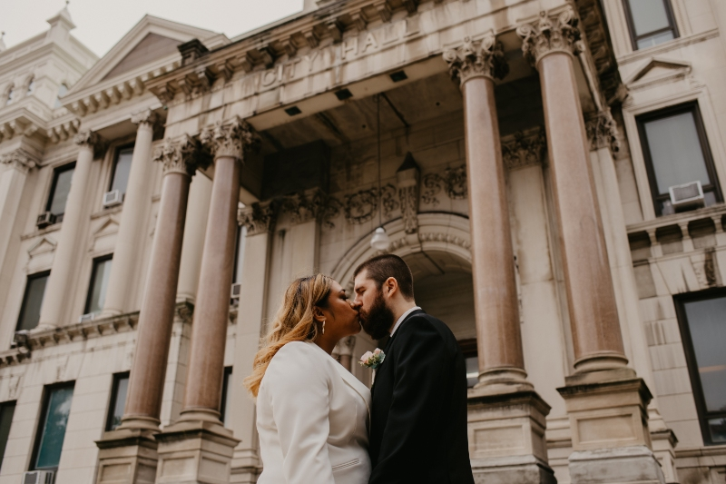 Bride and Groom kiss outside city hall after elopement