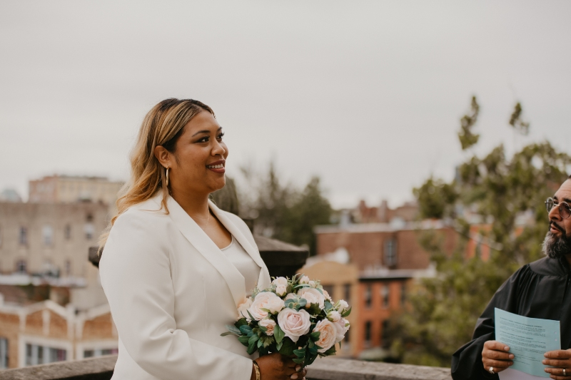 Bride looks at groom at Jersey City City Hall elopement