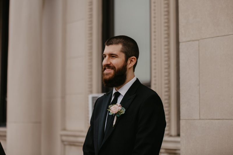 Groom looks at bride at Jersey City City Hall elopement