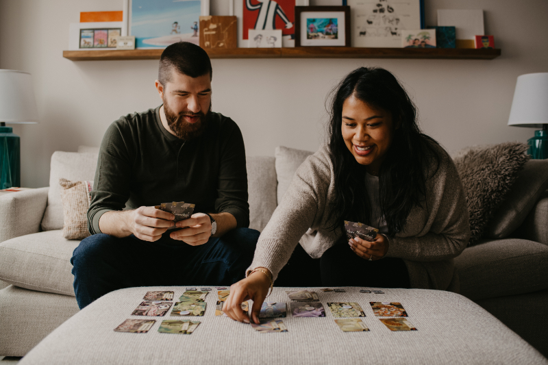 Engagement photos including your hobbies like playing cards together - unique engagement photos indoors