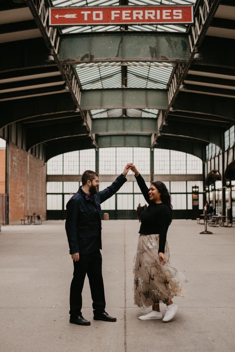 Engagement Photos dancing at the subway station