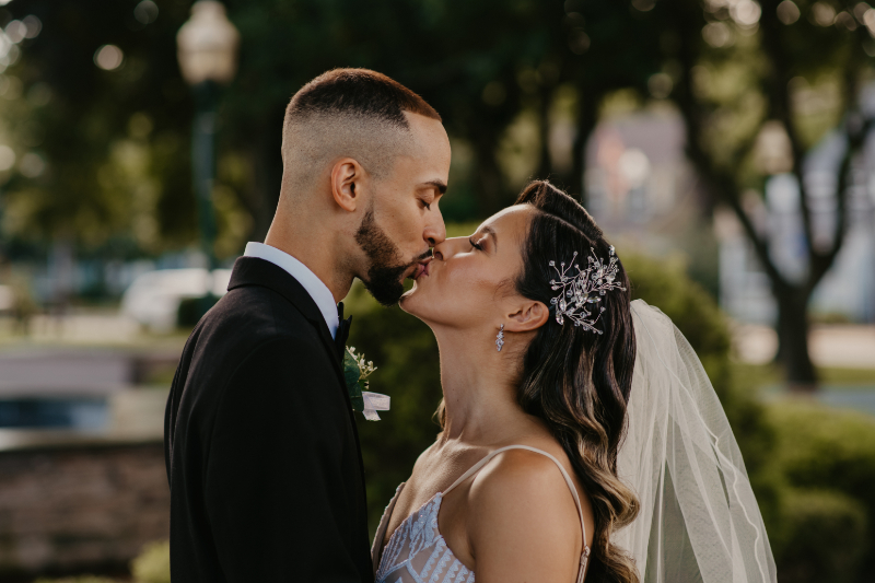 Bride and groom kiss after their summer wedding in New Jersey