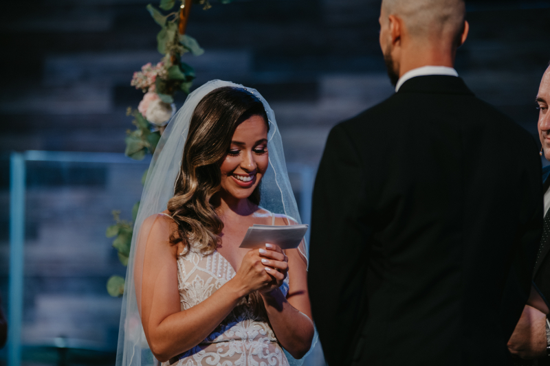 Bride reads vows from her notecards at the church ceremony