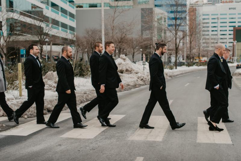 groomsmen crossing the street