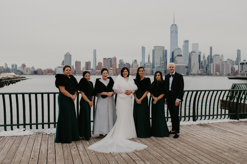 Bride with her family in front of New Jersey waterfront