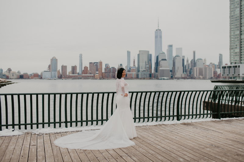 winter wedding photos of the bride in front of New Jersey waterfront