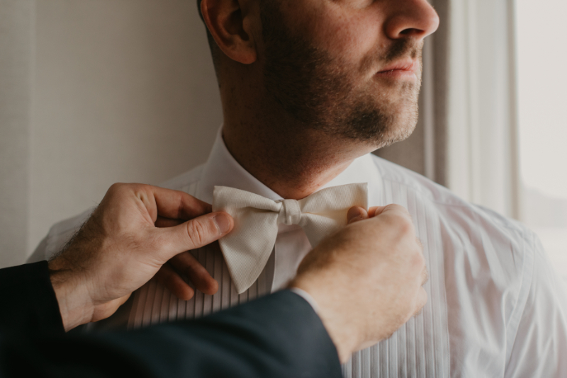 groom getting ready photos with bow tie