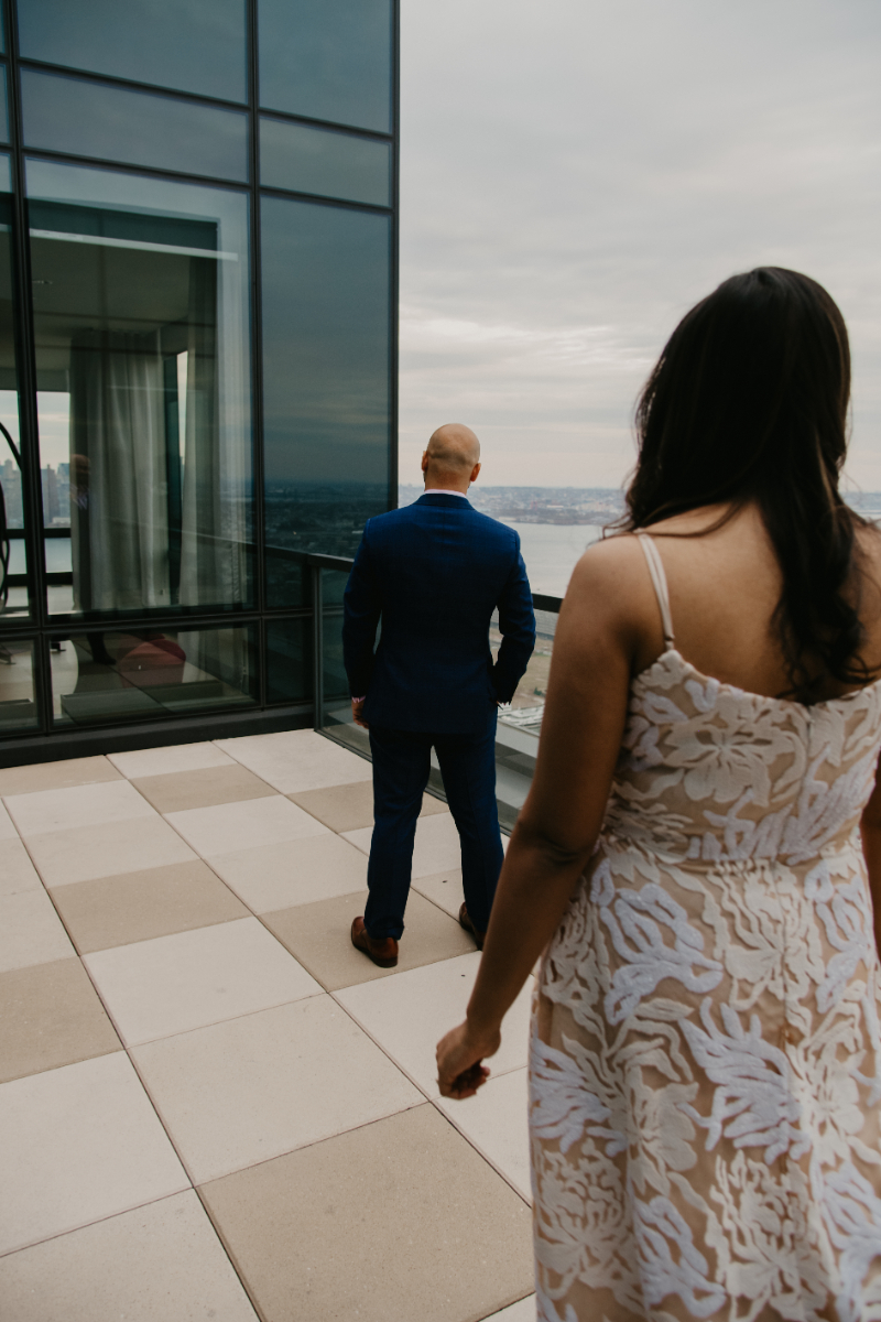 Rooftop first look wedding photos in Jersey City