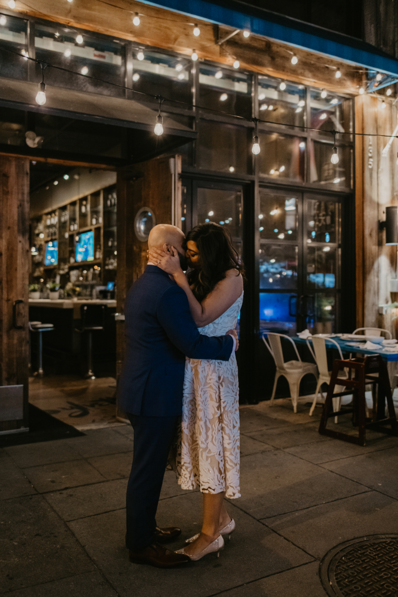 bride and groom kiss outside of micro wedding reception venue