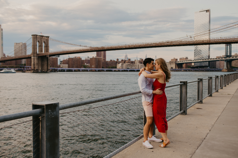 Outdoor engagement photos in front of the Brooklyn Bridge