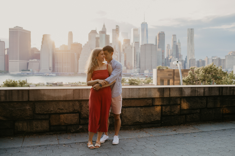Outdoor engagement photos in front of the New York City Skyline