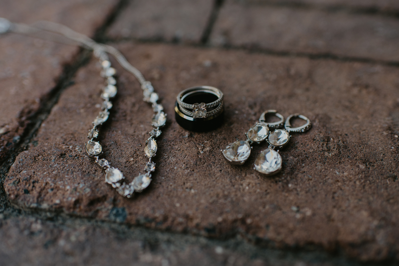 Stunning jewelry and rings on brick ground