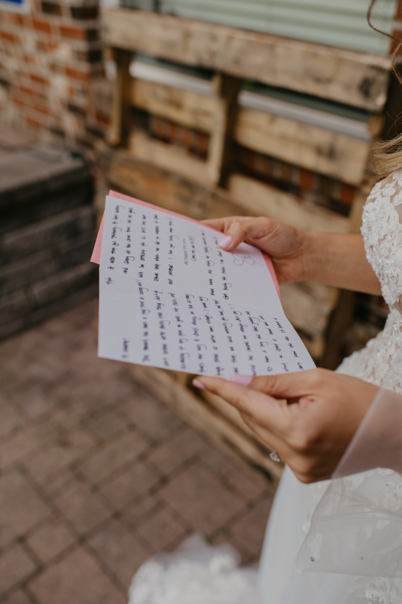 Bride reading a letter before the ceremony