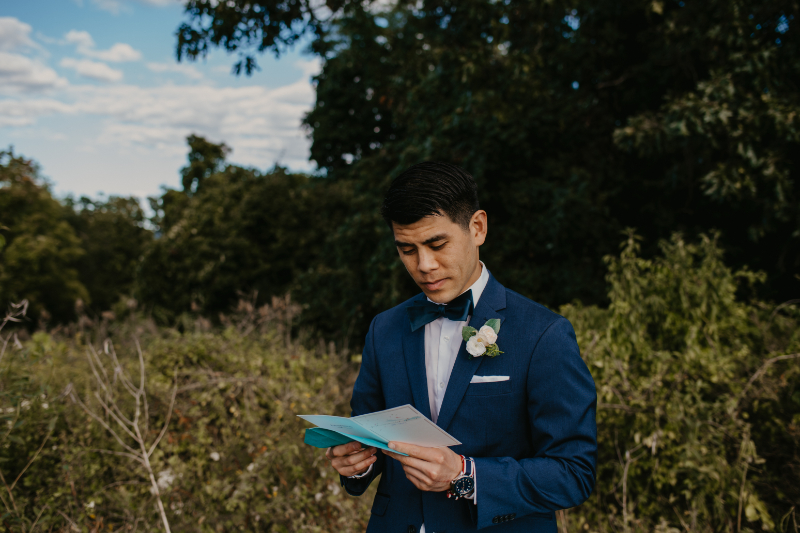 Groom reading a letter before the ceremony