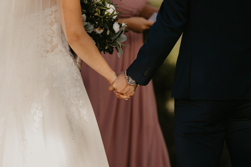 bride and groom closeup holding hands