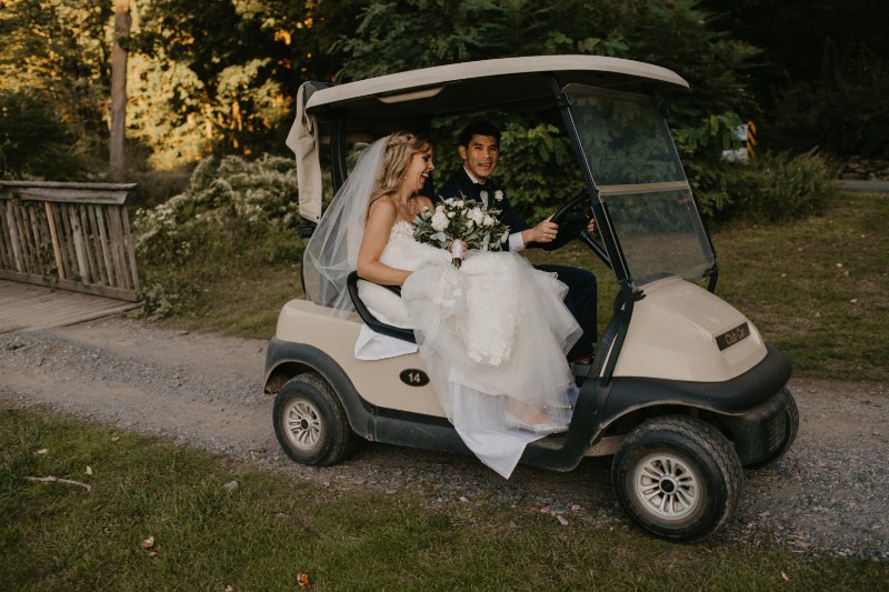 Bride and Groom Riding a Golf Cart
