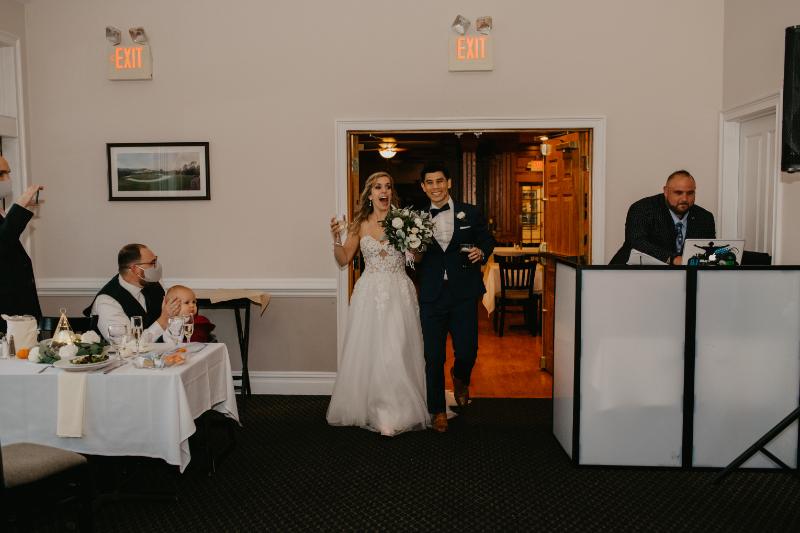 Bride and groom enter micro wedding reception venue