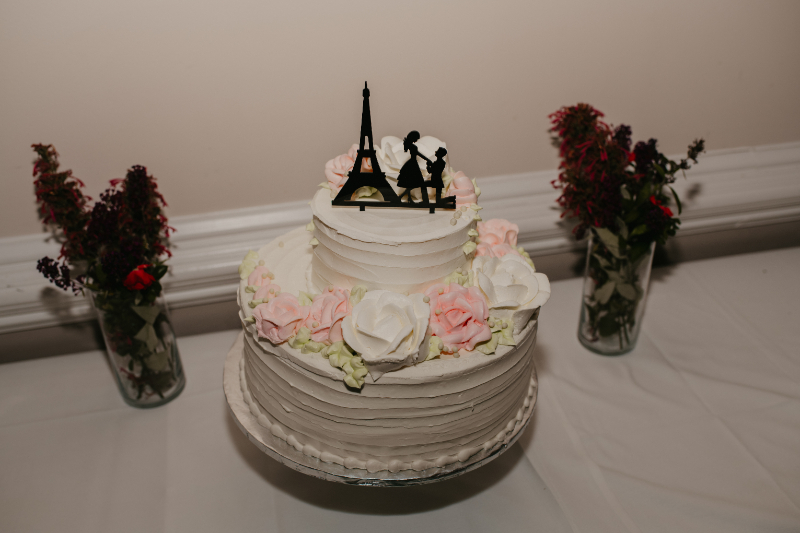 wedding cake with paris proposal topper